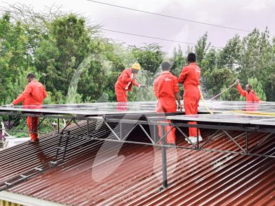 Solar panels being installed at the plaster house