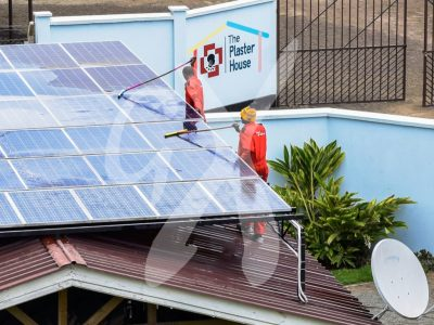 Multiple solar panels being serviced by gadgetronix solar experts