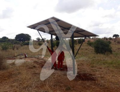 Experts working at installing the solar power system at Nasikia camp